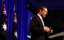 FILE: Australian Prime Minister Tony Abbott on Monday dropped a signature plan for paid parental leave. Picture: AFP