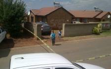 FILE: Crime scene investigators outside the Vosloorus house where Bafana Bafana captain Senzo Meyiwa was killed. Picture: Sapa.