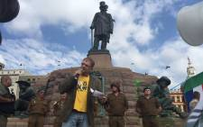 Afrikaans singer Steve Hofmeyer singing 'Die Stem' next to the Paul Kruger statue in Pretoria on 8 April 2015. Picture: Reinart Toerein/EWN.