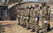 Rangers stand in salute by a monument remembering rangers who lost their lives in the line of duty in the Kruger National Park. Picture: Abigail Javier/EWN