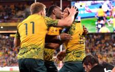 Australian players celebrate a try against the All Blacks in their Bledisloe Cup match on 21 October 2017 at the Suncorp Stadium in Brisbane. Picture: @AllBlacks/Twitter