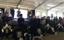 Families of the five miners who died at Sibanye Stillwater's Kloof Ikamva Shaft light candles in remembrance of their beloved sons, fathers, brothers. Picture: @_AMCU/Twitter.