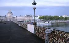 'Love padlocks' attached to a fence of the Pont des Arts bridge over the Seine river in Paris. Picture: AFP.