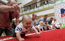 Babies crawl during a baby race to mark international Children's Day in Vilnius, Lithuania. Picture: Screengrab.