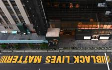 A newly painted Black Lives Matter mural adorns Fifth Avenue outside of Trump Tower on July 10, 2020 in New York City. Picture: AFP.