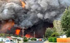 This handout picture taken and received from Kelly-ann Oosterbeek on 8 November 2019 shows flames from an out of control bushfire seen from a nearby residential area in Harrington, some 335 kilometers northeast of Sydney. Picture: AFP
