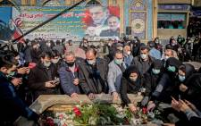 Iranian mourners attend the burial ceremony of slain nuclear scientist Mohsen Fakhrizadeh at Imamzadeh Saleh shrine in northern Tehran, on 30 November 2020. Picture: AFP