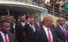 Zulu King Goodwill Zwelithini, surrounded by his bodyguards, arrives at the Moses Mabhida Stadium ahead of his address following attacks on foreign nationals in the province. Picture: EWN.