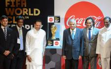 Sri Lankan Prime Minister Ranil Wickremesinghe (3R), Sports Minister Dayasiri Jayasekara (3L) and French football player Christian Karembeu (2R), a 1998 FIFA World Cup champion, take part in a ceremony for the FIFA World Cup Trophy Tour in Colombo on 24 January 2018. Picture: AFP.