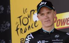 FILE: This file photo shows Great Britain's Christopher Froome celebrating on a podium after winning the 167 km tenth stage of the 102nd edition of the Tour de France cycling race on 14 July 2015 between Tarbes and La Pierre-Saint-Martin, southwestern France. Picture: AFP.