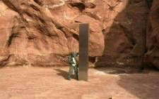 This video grab image obtained 24 November 2020 courtesy of the Utah Department of Public Safety Aero Bureau shows a mysterious metal monolith that was discovered in Utah after public safety officers spotted the object while conducting a routine wildlife mission. Picture: AFP.