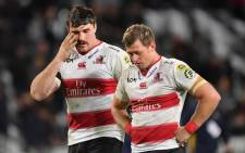 Lions' Ruan Combrinck (right) with teammate Lourens Erasmus walk from the field dejected after their loss during the Super Rugby match between the Highlanders from New Zealand and the Lions from South Africa on 12 May 2018.  Picture: AFP.