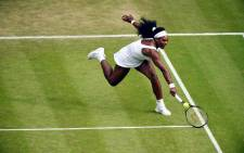 Serena Williams stretches as she hits the ball during a match at Wimbledon 2015. Picture: Wimbledon/Facebook.