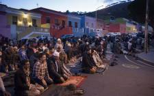 FILE: Men pray after Iftar, which is the evening meal which breaks the daily Ramadan fast for Muslim people, in the middle of Wale Street in Bo-Kaap, on 1 June 2018. Picture: AFP