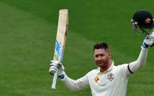 Australia's batsman Michael Clarke celebrates his century on the second day of the first Test cricket match between Australia and India at the Adelaide Oval on 10 December, 2014. Picture: AFP.