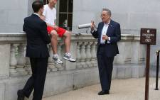 This picture of US senators Ben Sasse (left, in red shorts) and Chuck Schumer has gone viral, with people creating memes.