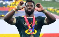 South Africa captain Siya Kolisi celebrates after victory in the third rugby union Test match between South Africa and the British and Irish Lions at the Cape Town Stadium in Cape Town on 7 August 2021. Picture: Rodger Bosch/AFP