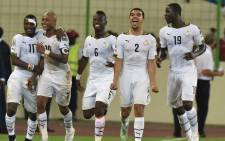 Ghana's midfielder Andre Ayew (2ndL) is congratulated by teammates after scoring a goal during the 2015 African Cup of Nations semi-final football match between Equatorial Guinea and Ghana in Malabo, on 5 February, 2015. Picture: AFP