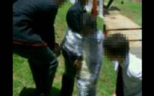 Image doing the rounds on social media of pupils being cling-wrapped to a pole at Parktown Boys High School. Picture: Supplied