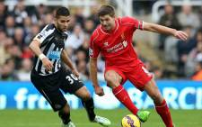 Newcastle United's French midfielder Mehdi Abeid (L) challenges Liverpool's English midfielder Steven Gerrard. Picture: AFP.