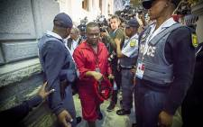 An Economic Freedom Fighters Member of Parliament is being escorted out of Parliament after they were kicked out during the State of the Nation Address in Cape Town on 12 February 2015. Picture: Thomas Holder/EWN.