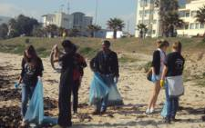 The President's Award Cape Town Youth Committee celebrated Nelson Mandela's birthday by having a beach clean up on Thermos Beach near Cape Town Stadium. Picture: Lize-Mari Doubell/iWitness