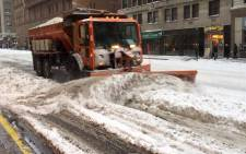 A snow plough clears the streets of New York. Picture: Annwen Quilliam.