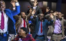 Zimbabwe's members of parliament celebrate after Mugabe's resignation on 21 November 2017 in Harare. Picture: Jekesai Njikizana/AFP