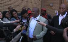 EFF leader Julius Malema addressed the media outside the North Gauteng High Court in Pretoria on 25 August 2014 after his provisional sequestration case was postponed to 1 December. Picture: Reinart Toerien/EWN