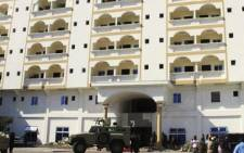 Somali terror group al Shabaab drove a car packed with explosives through main gate of the Jazira hotel. Picture: Twitter via @SomaliaPoliticsForum.