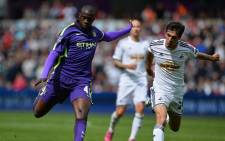Manchester City's Ivorian midfielder Yaya Toure (L) shoots to score their third goal during the English Premier League football match between Swansea City and Manchester City at The Liberty Stadium in Swansea, south Wales on 17 May, 2015. Picture: AFP.
