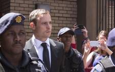 Oscar Pistorius leaves the High Court in Pretoria after his sentencing hearing on 17 October 2014. Picture: Christa Eybers/EWN.