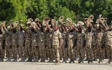 Nigerian military troops salute Nigeria's President during his visit to troops on front lines of Boko Haram conflict, on 28 November 2018, in Maiduguri as part of a military staff annual conference. Picture: AFP
