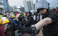 Police clear pro-democracy protesters from Lung Wo Road, next to the Hong Kong Chief Executive's Office, part of the Central Government Office complex that the protesters are trying to surround, in Hong Kong, China, on 1 December 2014. Picture: EPA.