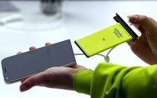 A hostess shows the switching of components of the South Korean LG Electronics new G5 smartphone, a new smartphone concept that allows to swap different parts of the phone, during a preview day of the Mobile World Congress in Barcelona, Spain, 21 February 2016. Picture: EPA/TONI ALBIR