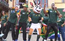 Musician Lloyd Cele performs on stage with the Springbok mascot during the team's send off at Monte Casino. Picture: Vumani Mkhize/EWN.