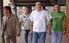 A file photo taken 04 September 2006 shows Dobrosav Gavric (2ndL), Milan Djurisic (L), Stojan Rankovic (2ndR) and Vujadin Krstic walking to a Belgrade court. Picture: AFP.