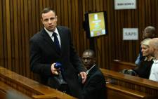 Oscar Pistorius on the second day of his murder trial on 4 March 2014 at the North Gauteng High Court in Pretoria. Picture: Pool.