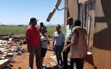 Johannesburg Mayor Herman Mashaba pictured with residents on 31 December 2017 after a storm affected the city and surrounding areas. Picture: @HermanMashaba/Twitter