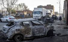 Burnt shells of cars after looters and rioters set fire to foreign owned vehicles and workshops. Picture: Thomas Holder/EWN.