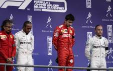 Winner Ferrari's Monegasque driver Charles Leclerc (2R), second-placed Mercedes' British driver Lewis Hamilton (2L) and third-placed Mercedes' Finnish driver Valtteri Bottas (R) react on the podium after the Belgian Formula One Grand Prix at the Spa-Francorchamps circuit in Spa on 1 September 2019. Picture: AFP.