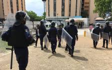 SA Police Service officers are seen among students at the University of Cape Town. Picture: @varsitynews/Twitter.