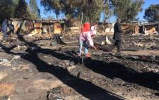 Primrose residents clear away what's left of their homes following a fire in the area. Picture: Mia Lindeque/EWN