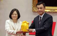 Taiwan's President Tsai Ing-wen (L) receives two national seals from the Parliament Speaker Su Chia-chuan during the inauguration ceremony at the Presidential Palace in Taipei. Picture: Taipei Photojournalists Association/Pool/AFP.