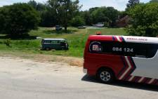 ER24 officials pictured on scene where 10 children where injured after the minibus they were travelling in veered off the road. Picture: er24.co.za