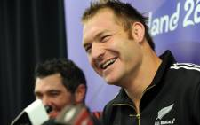 New Zealand All Black lock Ali Williams (R) speaks as teammate Stephen Donald (L) listens during a press conference in Auckland, on October 19, 2011. Picture: AFP