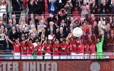 FILE: FA Cup holders Manchester United celebrate after beating champions Leicester City 2-1 in England. Picture: Twitter @ManUtd.
