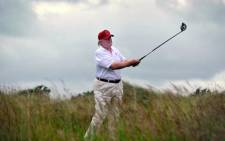 FORE!: Donald Trump in action on the golf course.