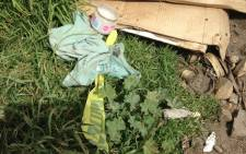 FILE: A small piece of police tape  on the ground after police cordoned off the area where a mother and her son were killed in Villiersdorp. Picture: Lauren Isaacs/EWN.