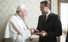 The handout picture made available by the Vatican newspaper 'Osservatore Romano' shows Pope Francis and US actor Leonardo Di Caprio during a private audience at the Vatican on 28 January 2016. Picture: EPA/Osservatore Romano.